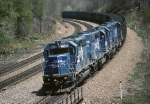 Still wearing their blue ,12,000 h.p. worth of Norfolk Southern SD-40-2s are leaning hard into an eastbound coal train