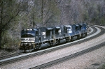Two sets of Norfolk Southern EMD SD-80MAC's (one dipped in black and one still in blue) head west to South Fork
