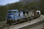"Norfolk Southern G.E. C-40-8W 8379 and a still unpainted ""catfish"" drag a mixed freight west"