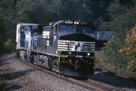Norfolk Southern GE C-40-9W 9518 rounds a sharp curve eastbound with  a J.B. Hunt trailer train