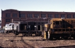 "Behind the massive Juniata shop sit a few Penn-Central derelicts. Closest to the camera is a U-33-C that has serious fire damage, an RS-11 that sits on boxcar trucks and will probably never run again and an ex-New York Central E-unit still in ""cigar band"""