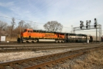 BNSF 5929 leads empty CEFX hoppers
