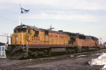 A pair of Union Pacific units relax in front of the Conrail flag fluttering in the breeze