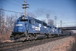 Conrail GP-40-2 3331 leads a GP-30 and a GP-9 west with empty hoppers