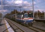 Amtrak AEM-7 913 zips by southbound