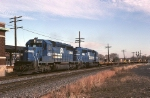 A pair of Conrail EMD SD-40-2's have empty TTX flats heading west along the still double tracked Lehigh line