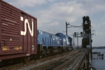 Conrail EMD SD-38 6937 & MT-6 1121 head out onto the Upper Bay drawbridge with a cut of cars