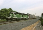 Burlington Northern EMD SD-40-2 6802 slides by eastbound with a Multi-Level train