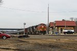 BNSF 4432 passing the depot with a string of eastbound oil cans