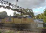UP 5207 leading an eastbound manifest straight out of the sun