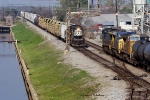 NS's transfer returning from the CN passes UP-bound CSX train Q-601-21 at Frenchman Street on NS Back Belt