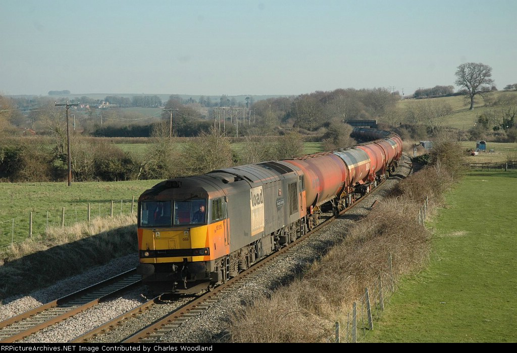EWS 60059 on diverted Theale - Robeston fuel tanks passing Great Cheverell with only full remaining Load Haul liveried class 60