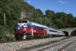 Metro-North FL-9AC 2045 bursts out of the tunnel northbound