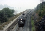 Amtrak EMD E-8A 267 slips by southbound along a fog shrouded Hudson River