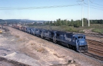 Conrail C-30-7A 6585 leads 4 other GE products out of the yard