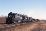 Penn-Central EMD GP-39 7917 and a pair of EMD GP-20's storm out of Alfred E. Perlman yard for the west