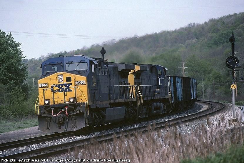 CSX GE AC44CW 305 leads a ballast train eastbound