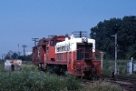 Illinois Central Gulf SW-7 1201 runs a caboose hop thru the crossing