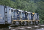 CSX GE AC44CW 148 leads three 4 axle EMD's out of the yard on a mixed freight