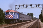 Metra F-40-PHM-2 186 scoots west along the Burlington Northern