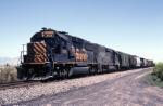 Denver & Rio Grande Western GP-60 3156 speeds along the Sunset Route with boxcar freight