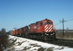 Canadian Pacific M-630 4562 and three other MLW's hustles mixed freight across the frozen landscape