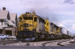 Atchison, Topeka & Santa Fe SD-45-2 5640 is really moving thru town with a hot intermodal