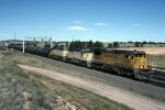 Union Pacific General Electric C-40-8 9201 drags a mixed freight along with two faded EMDs