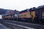 CSX EMD SD-50 8563 heads out of town with a coal train