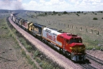 Atchison, Topeka & Santa Fe FP-45 97 rips thru with  a long mixed freight