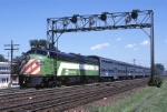 Burlington Northern Electro-Motive Division E-9U 9901 pulls away from its station stop