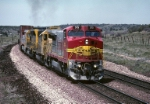 Atcihson, Topeka & Santa Fe GE B-40-8W 515 is really moving with a double-stack