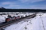 Atchison, Topeka & Santa Fe GE B-40-8W 528 leads a piggybacker thru the snowy landscape