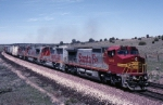 Atchison, Topeka & Santa Fe GE C-40-8W 883 and three more warbonnets pull mixed freight along the perfectly manicured Seligman Sub