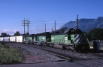 Burlington Northern EMD SD-40-2 6364 is northbound with mixed freight