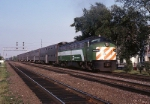 Burlington Northern EMD E-9U 9923 is westbound with double-decker commuter cars