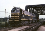A pair of Belt Railway of Chicago ALCo Century 424's have a caboose hop