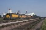 Chicago Northwestern EMD SD-402 6905 brings a unit coal train thru the interlocking