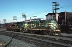 Central Vermont Electro-Motive GP-18 3614 pulls a caboose hop across CV crossing