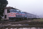 Metra EMD F-40PH 125 has two double-decker commuter cars in tow at 16th Street junction