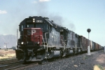 Southern Pacific EMD SD-40M-2 8650 speeds along the Sunset Route with boxcar freight