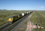 Wyoming's wide open spaces are readily apparent as Union Pacific GE C-40-8 9144 eats up the miles with a hot piggybacker