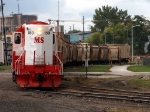 Michigan Shore 180 brings a train of sand cars into North Yard