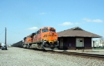 BNSF 5765 is now shoving GRDA coal drag north past the old MP depot