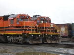Two locomotives side by side.