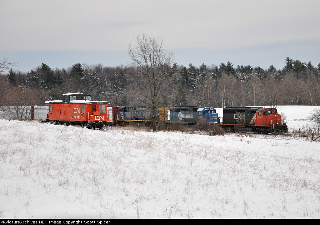 CN power leads the Q620-14 past a privately owned and refurbished CN Caboose on the CSX St. Lawrence Subdivision