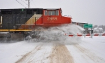CN 2656 blows through a small snow bank