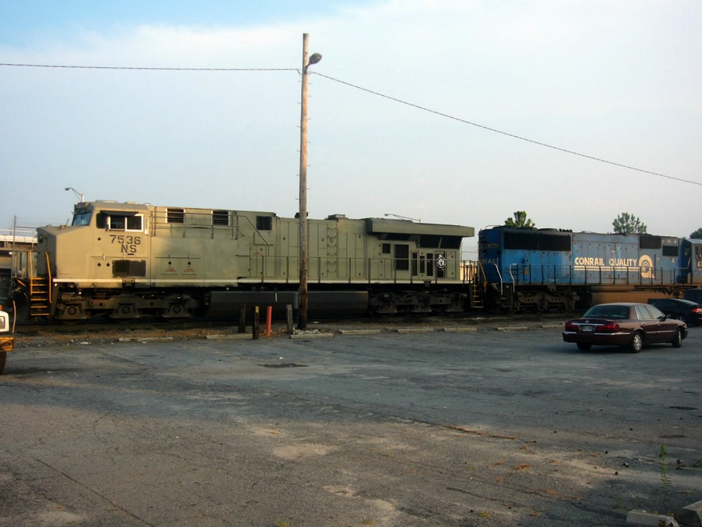 NS ex Conrail Patched GM/EMD SD60I 6742 and Primered NS GE ES40DC 7536 idle at the NS Engine Facility