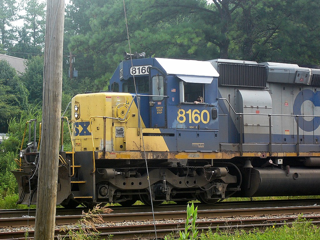 CSX GM/EMD SD40-2 8160 in CSX's YN2 Paint Sits Waiting to Move through the Montreal Road Grade Crossing