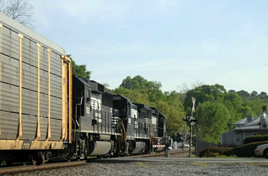 A Northbound Intermodal with 2 GM/EMD GP60s sandwiching a GE B32-8